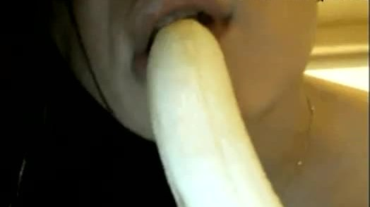 Naughty indian babe sucking a banana on camera